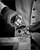 A barista preparing espresso