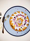 Berry bundt cake with freeze dried berries and edible rose petals