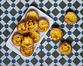 Fresh egg baked tarts on tray