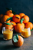 Orange juice and orange on table