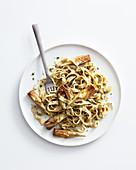 Tagliatelle made from chickpea flour with artichokes and hazelnuts