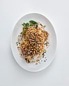 Chicken in cream sauce with walnut-garlic pesto