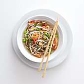 Noodle soup with edamame, spring onions and crispy bacon