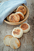 Homemade English muffins in a basket