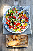 Country salad with cucumbers, tomatoes, peppers and onions