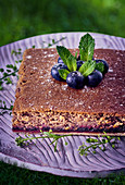 Lentil cake with blueberries and mint