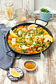 Paella with fish, pepper and green beans