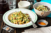 Spaghetti with chickpeas, spinach, courgette and dried tomatoes
