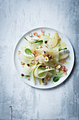 Pomelo and melon salad with pomegranate seeds