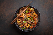Chinese soba stir-fry noodles with shrimps and vegetables