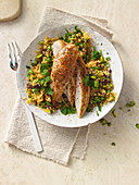 Chicken on orange spice couscous with pistachios and sultanas