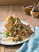 Baked potato with sliced pork tenderloin