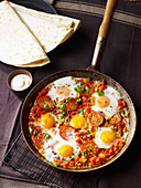 Mexican breakfast eggs with peppers and tomatoes