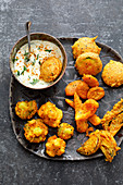 Indian vegetable pakoras with raita