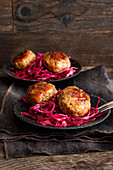 Roe deer patties on red cabbage salad