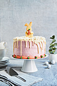 Easter cake with Easter Bunny biscuits and marzipan carrots