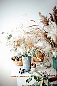 Wintry arrangement with dry grasses on table