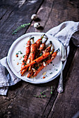 Baked carrots with a honey-thyme glaze and almond flakes