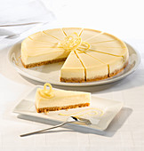 Lemon cheesecake with a biscuit base serves fourteen