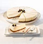 Vanilla cheesecake with a biscuit base serves fourteen