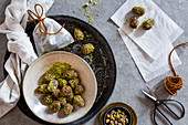 Easter eggs coated in dates, cocoa and pistachios as a gift