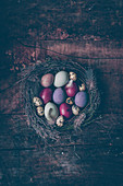 Naturally dyed Easter eggs in an Easter nest
