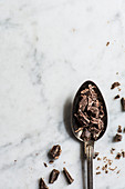 Chopped dark chocolate on a spoon