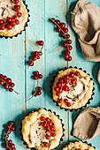 Puff pastry tartlets with chocolate and mascarpone cream and redcurrants