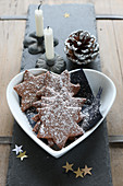 Gluten-free shortbread biscuits with cocoa, almonds and powdered sugar for Christmas