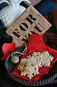 Gluten-free snowflake cookies on a red napkin with Christmas decorations