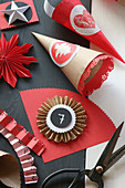 Handmade red and beige cones for Advent calendar