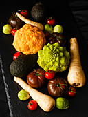 Various types of vegetables on a black surface