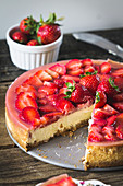 Strawberry cheesecake with an almond base, sliced