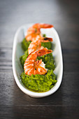 Prawns on mushy peas with mint and elderflower oil