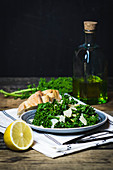 Kale salad with lemons, olive oil, pine nuts and Parmesan