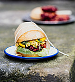 Burger with avocado, cress and beetroot