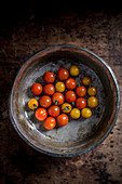 Cherry tomatoes in a ceramic bowl