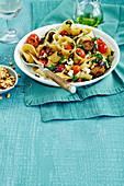 Pasta with pine nuts, feta and tomato