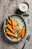 Bulgur with cranberries served with carrots and mint yoghurt