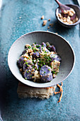 Purple potato salad with miso, green apples and peanuts