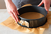 Baking paper being attached to a springform pan