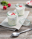 Herb quark with radishes in jars