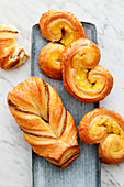 A nut pastry and vanilla puff pastry buns