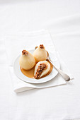 Grappa pears with raisin and biscuit stuffing