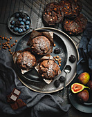 Coffee and chocolate muffins with berries