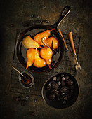 Poached pears with honey and vanilla served with berries
