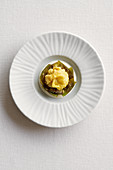 Stuffed artichoke on foam sauce (a dish by Roberto Tonola)