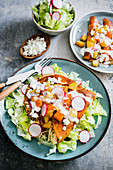 Enchiladas mineras: tortillas stuffed with vegetables and cheese, served on a salad