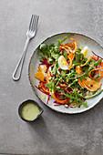 A fruit salad with avocado dressing