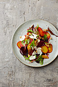 Colourful beet salad with goat's cheese and walnuts